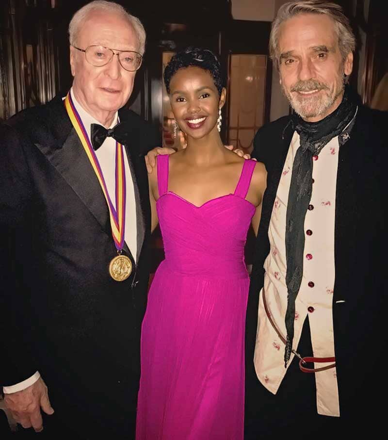 Ilwad Elman in beautiful fittedfuschia evening dress, with Sir Michael Caine & Jeremy Irons at the Academy of Achievement Summit Awards