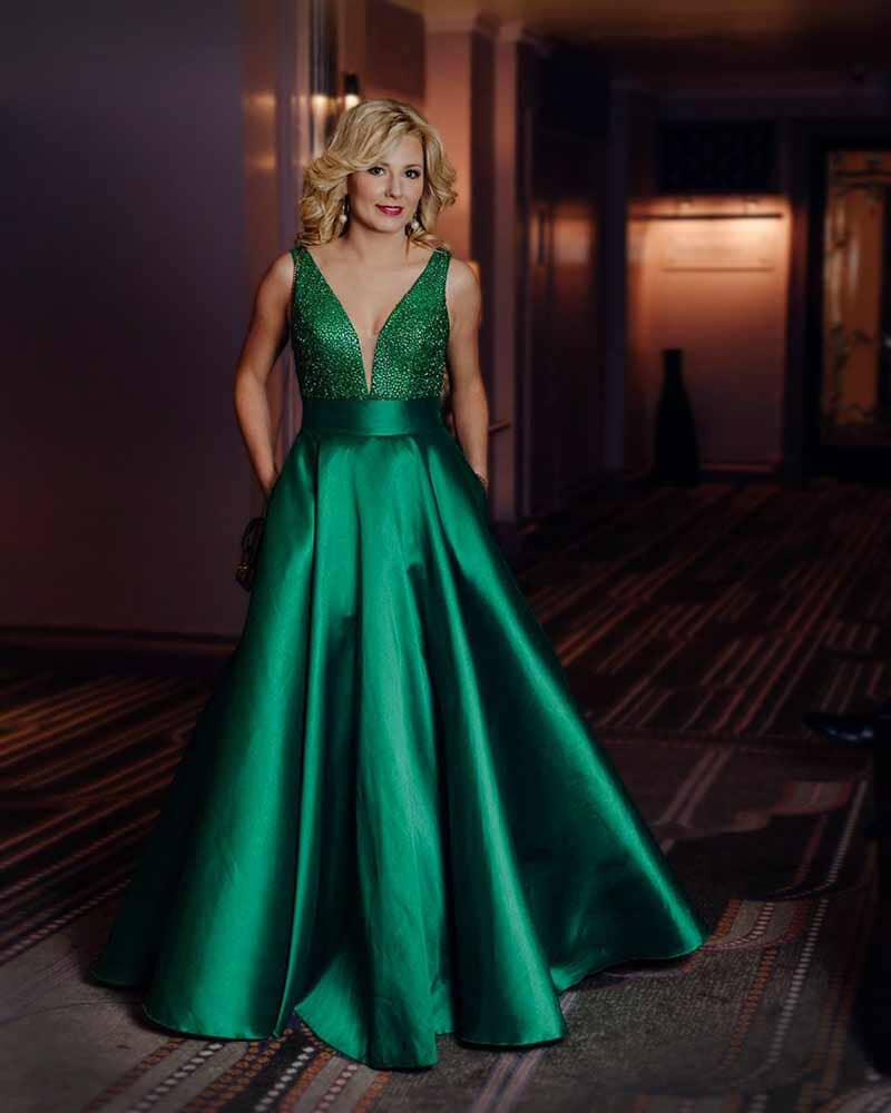 Gorgeous green satin ball gown, bodice is covered in sparkly glass beads & full satin skirt pulls in at the waist to create a beautiful silhouette.