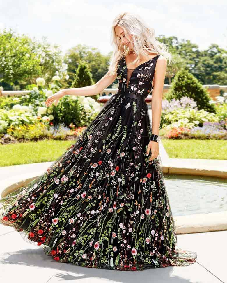A-Line evening gown, floral embroidered, with plunging neck and back.